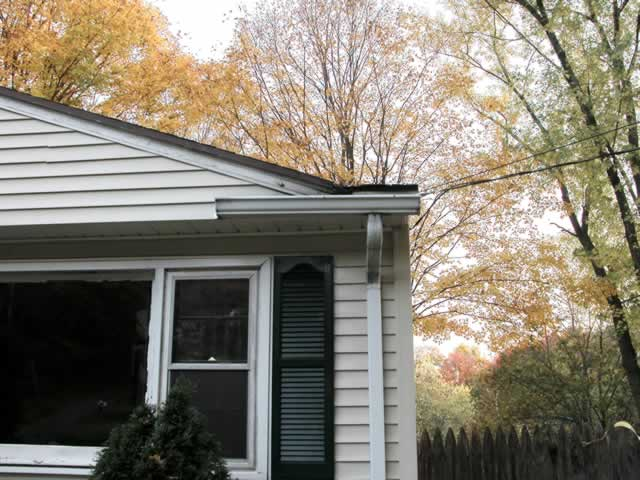 Clean The Dark Stains Off The Exterior Of Your White Gutters